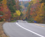 A Fall Drive On The Byway along Route 89 with yellow, red and orange leaves on the trees