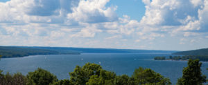 Long view of Cayuga Lake with sailboats in the distance