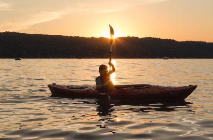 Kayaker at Sunset on Cayuga Lake Photo by Allison Usavage
