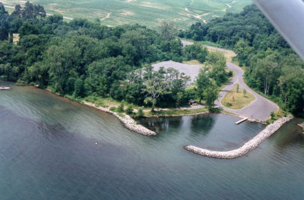 Aerial photo of Deans Cove State Boat Launch Area showing launch basin, parking area and entrance road