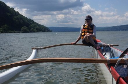 View of a Passenger on an outrigger paddlecraft on Cayuga Lake Photo by Susanna Pearce