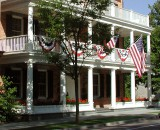 The Aurora Inn decorated for the Fourth of July with American flags and red, white and blue banners