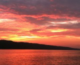 Bright orange, yellow and pink hues in the Sunset Over Cayuga Lake
